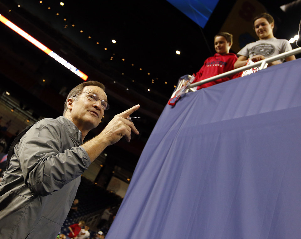 Photo - Oklahoma coach Lon Kruger points to a group of fans while signing autographs after practice on Final Four Friday before the national semifinal between the Oklahoma Sooners and the Villanova Wildcats in the NCAA Men's Basketball Championship at NRG Stadium in Houston, Friday, April 1, 2016. OU will play Villanova in the Final Four on Saturday. Photo by Nate Billings, The Oklahoman