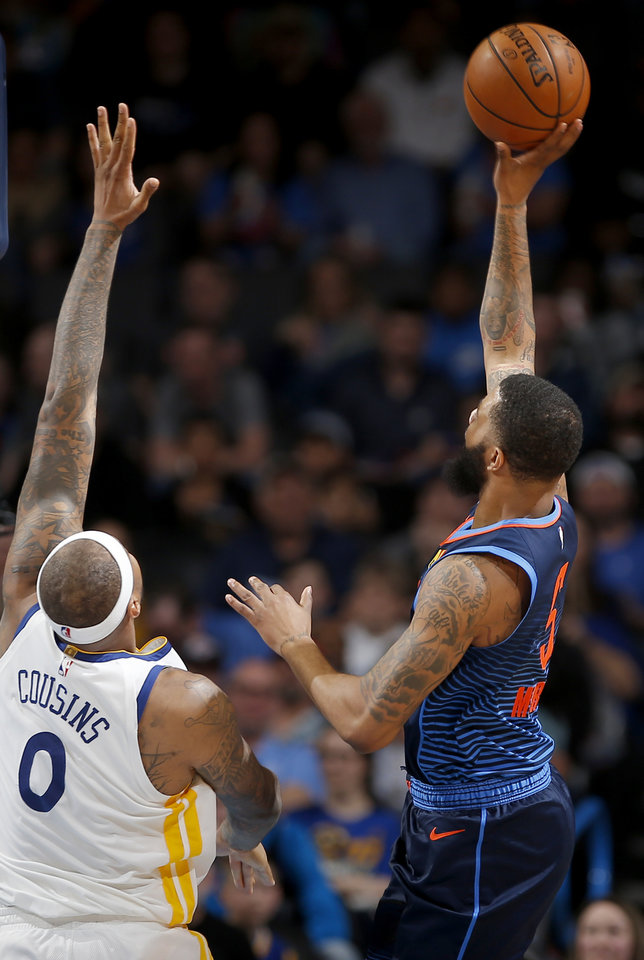 Photo - Oklahoma City's Markieff Morris (5) shoots over Golden State's DeMarcus Cousins (0) during the NBA basketball game between the Oklahoma City Thunder and the Golden State Warriors at Chesapeake Energy Arena,  Saturday, March 16, 2019. Photo by Sarah Phipps, The Oklahoman