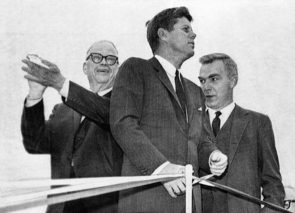Photo - President John F. Kennedy cuts the ribbon, formally opening the final link in scenic State Highway 103. Reported in The Oklahoman: