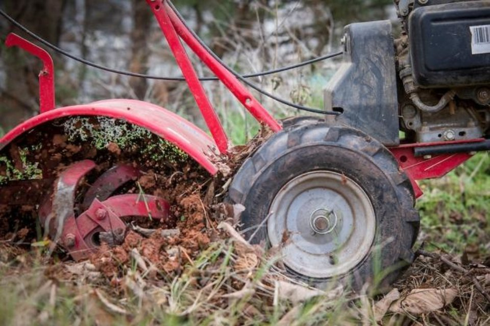 Photo -  Tilling leaves into soil for soil amendment is part of fall garden preparation.  [TODD JOHNSON/AGRICULTURAL COMMUNICATIONS SERVICES]