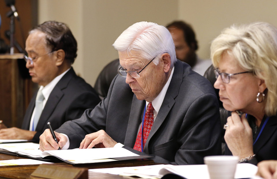 Photo - From left, Dr. R. Murali Krishna, Ronald Osterhout and Becky Payton. The Oklahoma State Department of Health voted at their monthly meeting Tuesday morning, July 10, 2018, to ban sales of smokeable forms of medical marijuana and to require dispensaries to hire a pharmacist. The Board of Health voted on 75 pages of rules creating a rough framework for patients, physicians, caretakers and business owners interested in medical marijuana. The ban on sales of leaves and flowers for smoking and the requirement to hire a pharmacist weren't in the draft rules presented to the board, but were a priority of a coalition of medical groups. Julie Ezell, the Health Department's general counsel, presented the rules to a packed board room and to members of the public watching in an overflow room and online. She cautioned board members that the two new rules they added might not be allowed under the state question, inviting a court challenge. Photo by Jim Beckel, The Oklahoman