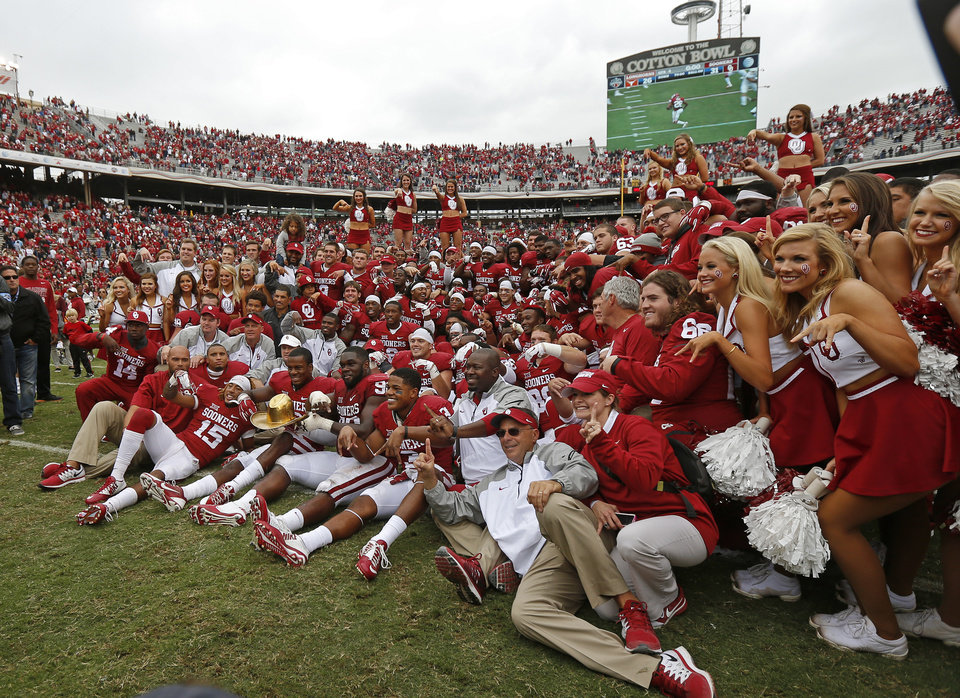 Photo - The OU team poses for a photo after their 31-26 win in the Red River Showdown college football game between the University of Oklahoma Sooners (OU) and the University of Texas Longhorns (UT) at the Cotton Bowl in Dallas on Saturday, Oct. 11, 2014. 