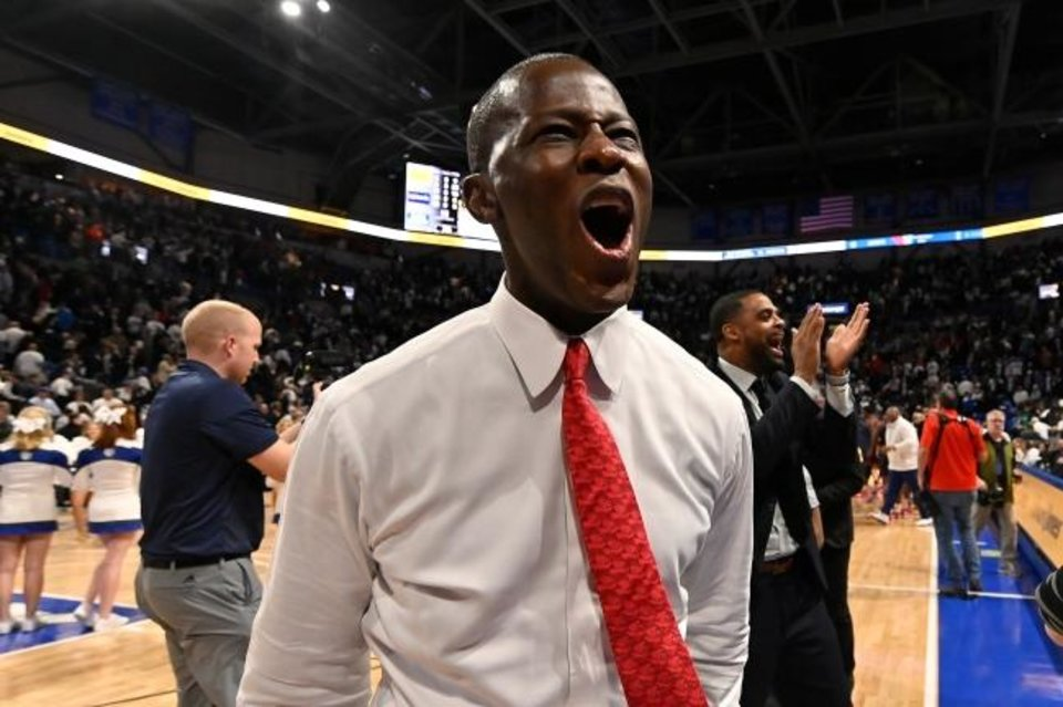 Photo -  Dayton coach Anthony Grant celebrates after his team defeated Saint Louis in overtime Jan. 17 at Chaifetz Arena. [Jeff Curry/USA TODAY Sports]
