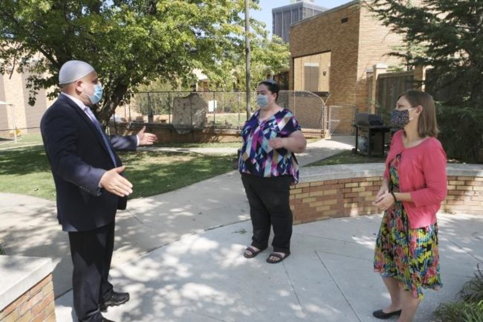Photo -  Imad Enchassi, senior imam of the Islamic Society of Greater Oklahoma City, talks with  Rabbi Abby Jacobson, spiritual leader of Emanuel Synagogue, center, and Rabbi Vered Harris outside Temple B'nai Israel, where Harris is the spiritual leader. [Doug Hoke/The Oklahoman]