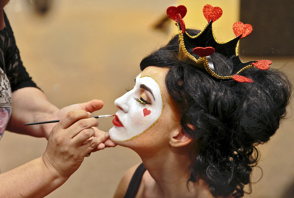 Photo - If you want to spend less but make a big impact, makeup can stand alone as a Halloween look. Here, makeup artist Sharon Tabb of The Makeup Room Agency, applies Queen of Hearts makeup to model Clancey. Photo by Chris Landsberger, The Oklahoman.  CHRIS LANDSBERGER