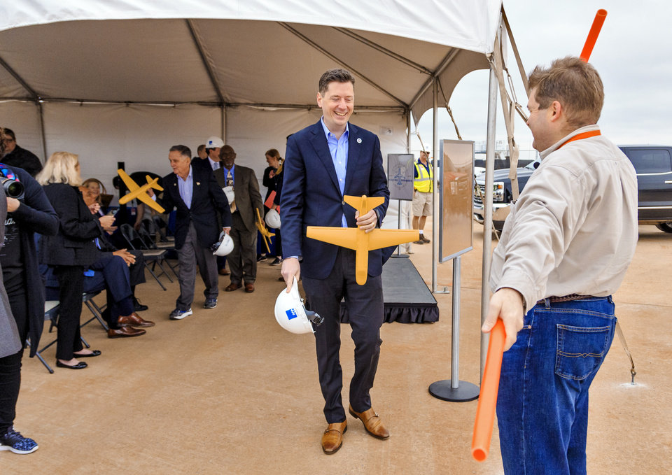Photo - Mayor David Holt is directed to the groundbreaking runway to launch a ceremonial plane during a ceremony for the official launch of the Will Rogers World Airport Terminal Expansion Project at the airport in Oklahoma City, Okla. on Friday, March 29, 2019. Photo by Chris Landsberger, The Oklahoman