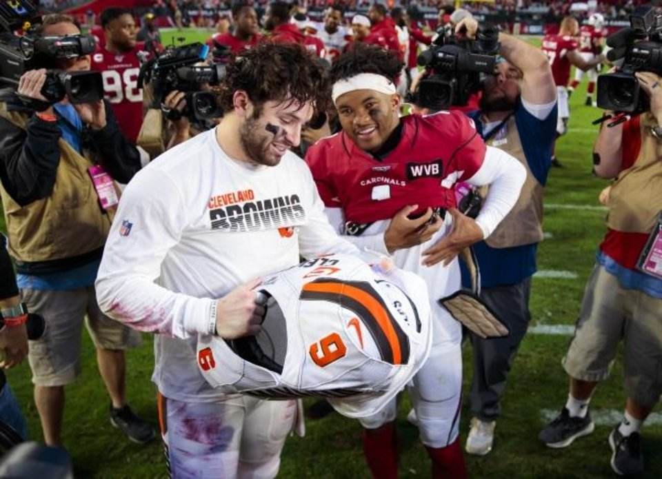 Photo -  Browns quarterback Baker Mayfield (left) exchanges jerseys with his former OU teammate Kyler Murray after the Cardinals won on Dec. 15. [Mark J. Rebilas/USA TODAY Sports]