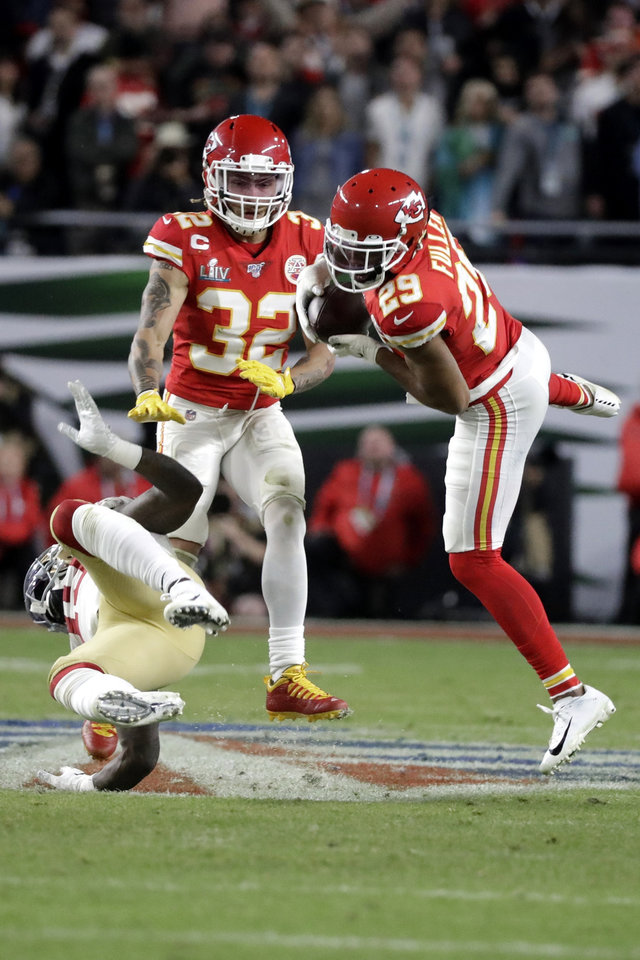Photo - Kansas City Chiefs' Kendall Fuller (29) intercepts a pass next to San Francisco 49ers' Deebo Samuel, bottom, during the second half of the NFL Super Bowl 54 football game Sunday, Feb. 2, 2020, in Miami Gardens, Fla. The Kansas City Chiefs won 31-20. (AP Photo/Wilfredo Lee)