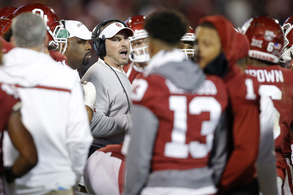Photo - Oklahoma defensive coordinator Alex Grinch talks with players during an NCAA football game between the University of Oklahoma Sooners (OU) and the Iowa State University Cyclones at Gaylord Family-Oklahoma Memorial Stadium in Norman, Okla., Saturday, Nov. 9, 2019. [Bryan Terry/The Oklahoman]