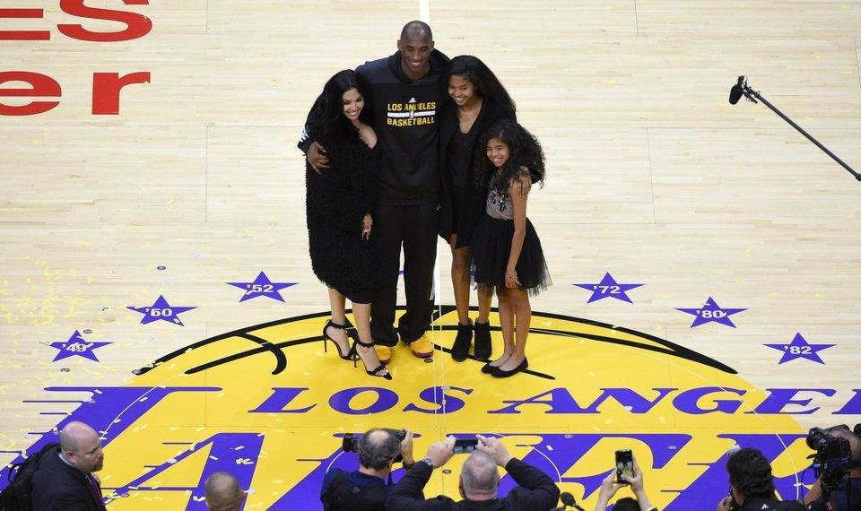 Photo -  FILE - In this April 13, 2016, file photo, Los Angeles Lakers' Kobe Bryant poses for pictures with his wife Vanessa, left, and daughters Natalia, second from right, and Gianna as they stand on the court after an NBA basketball game against the Utah Jazz, in Los Angeles. Bryant, the 18-time NBA All-Star who won five championships and became one of the greatest basketball players of his generation during a 20-year career with the Los Angeles Lakers, died in a helicopter crash Sunday, Jan. 26, 2020. [AP Photo/Mark J. Terrill]