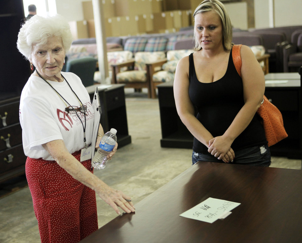 Photo   Nola Schuermann Helps Amanda Swann Of Moore Pick Out Furniture At  The Furniture Bank