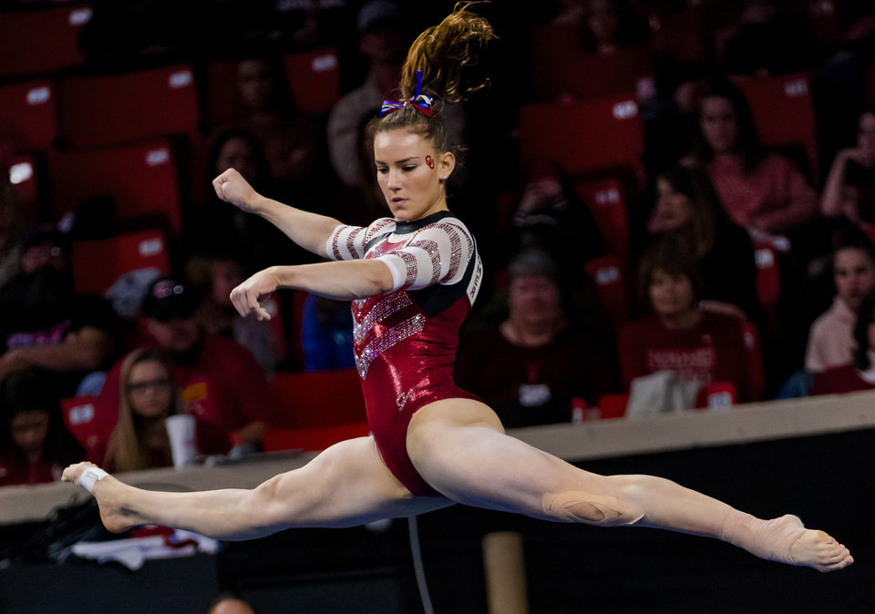 Photo - University of Oklahoma's Anastasia Webb competes in the floor routine during the women's gymnastics competition between the University of Oklahoma and Arkansas at the Lloyd Noble Center in Norman, Okla Monday, Jan. 20, 2020.   [Chris Landsberger/The Oklahoman]