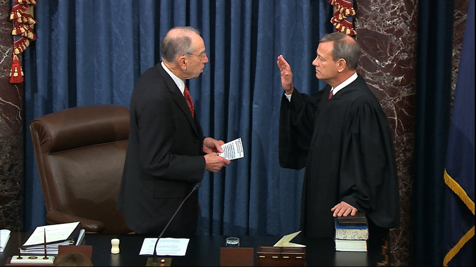 Photo -  In this image from video, President Pro Tempore of the Senate Sen. Chuck Grassley, R-Iowa., swears in Supreme Court Chief Justice John Roberts as the presiding officer for the impeachment trial of President Donald Trump in the Senate at the U.S. Capitol in Washington, Thursday, Jan. 16, 2020. (Senate Television via AP)