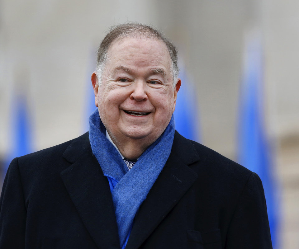 Photo - Former Oklahoma Gov. David Boren  smiles as he stands when introduced during the ceremony. Boren, a Democrat, served as the 21st Governor of Oklahoma from 1975 to 1979 and in the United States Senate from 1979 to 1994. He currently is the 13th President of the University of Oklahoma. Gov. Mary Fallin, Lt. Gov. Todd Lamb, and seven state officers were sworn in during a noon ceremony Monday, Jan. 12, 2015, on the south plaza of the Oklahoma State Capitol. Photo by Jim Beckel, The Oklahoman