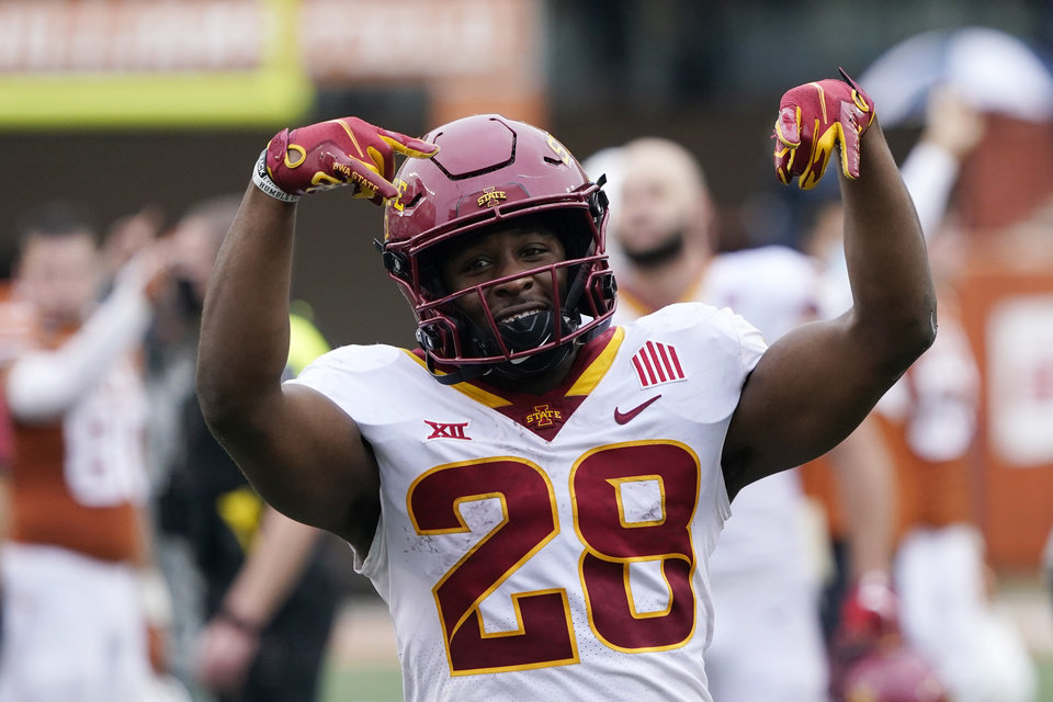 Photo - Iowa State running back Breece Hall (28) celebrates the team's win over Texas in an NCAA college football game, Friday, Nov. 27, 2020, in Austin, Texas. (AP Photo/Eric Gay)
