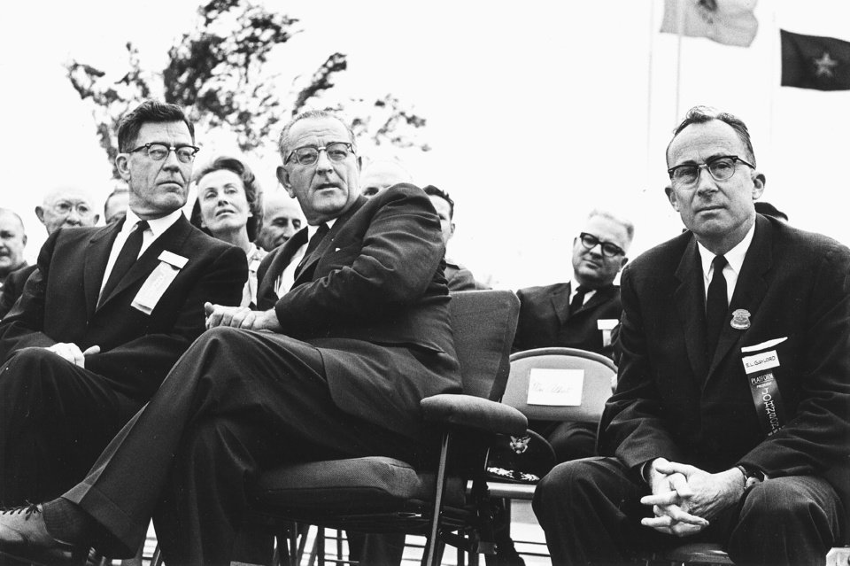 Photo - Edward L. Gaylord (right), Oklahoma State Fair Board president, shares the stage with Dean A. McGee and President Lyndon Johnson during President Johnson's 9/25/64 visit to Oklahoma City to dedicate the Fourteen Flags Plaza on the state fairgrounds. Staff photo by Austin Traverse taken 9/25/64.