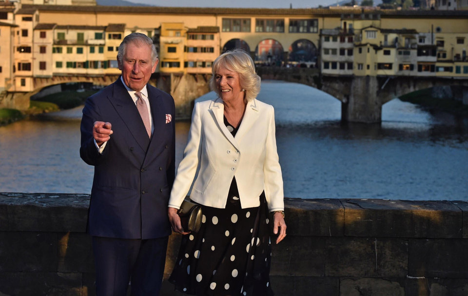 Photo - Britain's Prince Charles and his wife Camilla, the Duchess of Cornwall, stand on the Saint Trinity Bridge in Florence, Italy, March 31, 2017, as they pose for photos in front of historic Ponte Vecchio (old bridge). The royal couple is in Italy on the first day of a week-long trip including Rome and the Vatican. (Maurizio Degl'Innocenti/ANSA via AP)