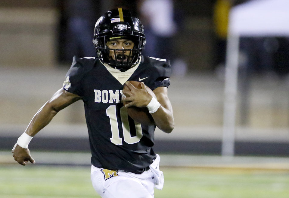 Photo - Midwest City's Deangelo Irvin, Jr. rushes during the high school football game between Midwest City and Del City at Del City High School in Midwest City, Okla., Friday, Oct. 9, 2020. Photo by Sarah Phipps, The Oklahoman