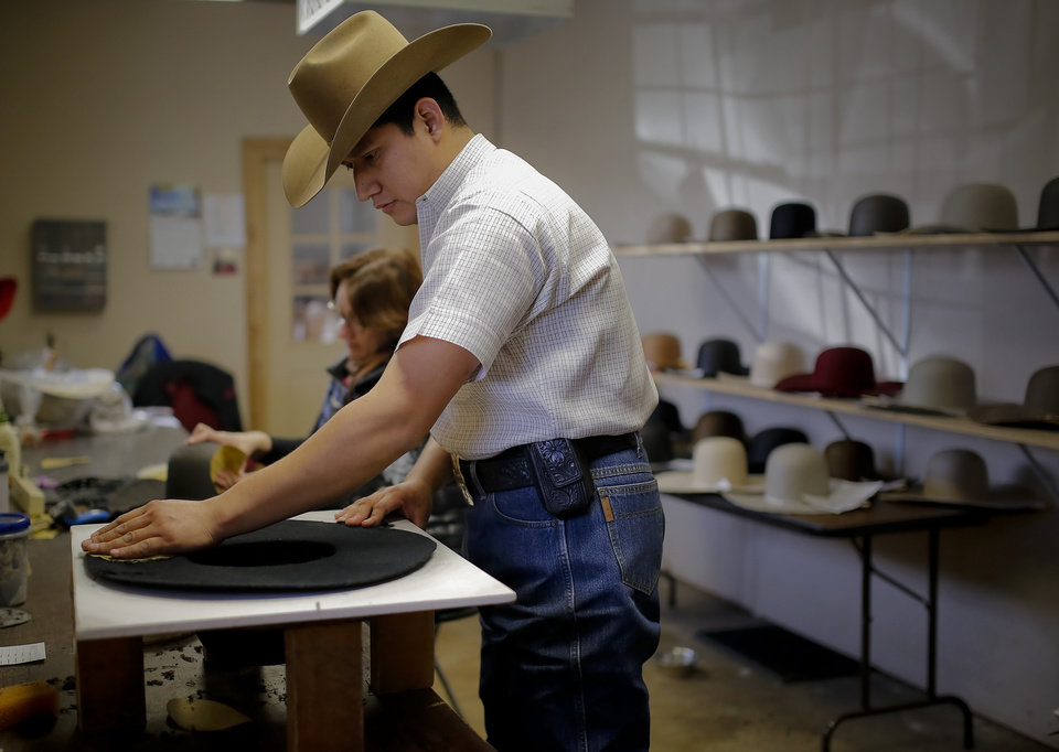 Rusbel Corrasco works on sanding the brim of a cowboy hat at Shorty s Caboy  Hattery in 1426c163c52