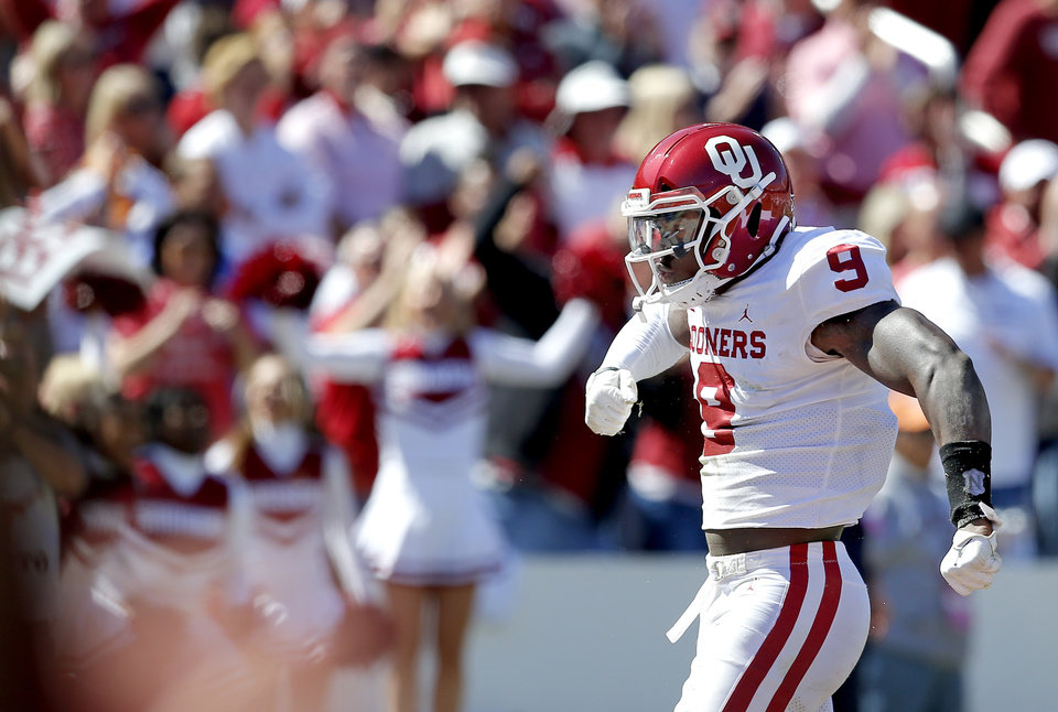 Photo - Oklahoma's Kenneth Murray (9) celebrates a play during the Red River Showdown college football game between the University of Oklahoma Sooners (OU) and the Texas Longhorns (UT) at Cotton Bowl Stadium in Dallas, Saturday, Oct. 12, 2019. OU won 34-27. [Sarah Phipps/The Oklahoman]