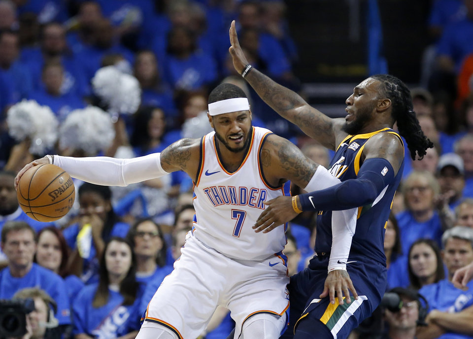 Photo - Oklahoma City's Carmelo Anthony (7) tries to get around Utah's Jae Crowder (99) during Game 1 in the first round of the NBA playoffs between the Oklahoma City Thunder and the Utah Jazz at the Chesapeake Energy Arena,  Sunday, April 15, 2018. Photo by Sarah Phipps, The Oklahoman