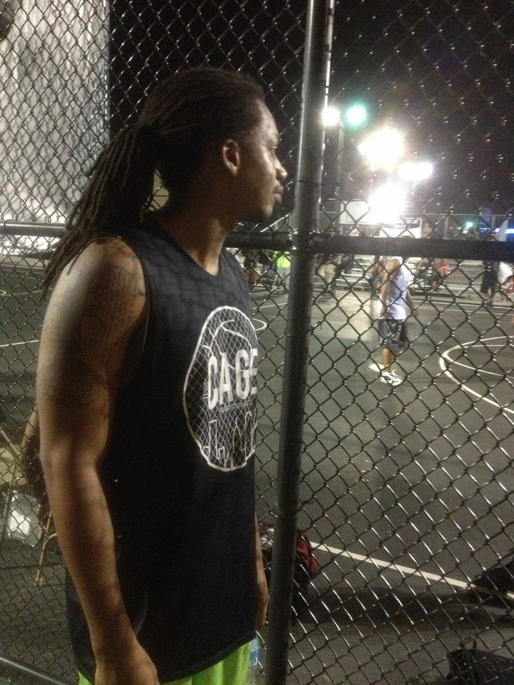 Photo - Avery Stevenson Jr. watches as teams play in The Cage downtown.  Provided