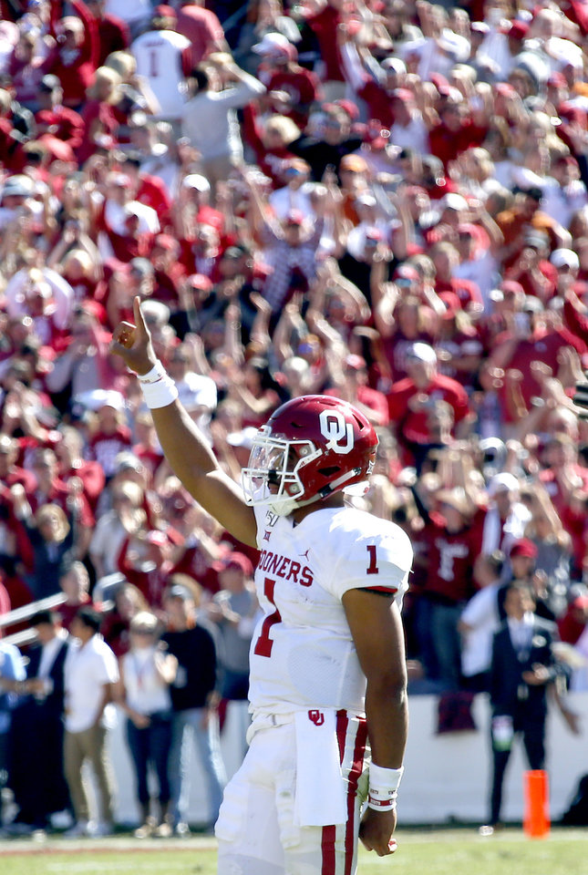 Photo - Oklahoma's Jalen Hurts (1) celebrates in the final seconds during the Red River Showdown college football game between the University of Oklahoma Sooners (OU) and the Texas Longhorns (UT) at Cotton Bowl Stadium in Dallas, Saturday, Oct. 12, 2019. OU won 34-27. [Sarah Phipps/The Oklahoman]