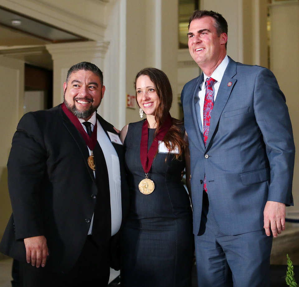 Photo - Robert and Wilmari Ruiz receive a Community Award from Governor Kevin Stitt at the Governor's Arts Awards at the Capitol, Tuesday, April 16, 2019. Photo by Doug Hoke/The Oklahoman