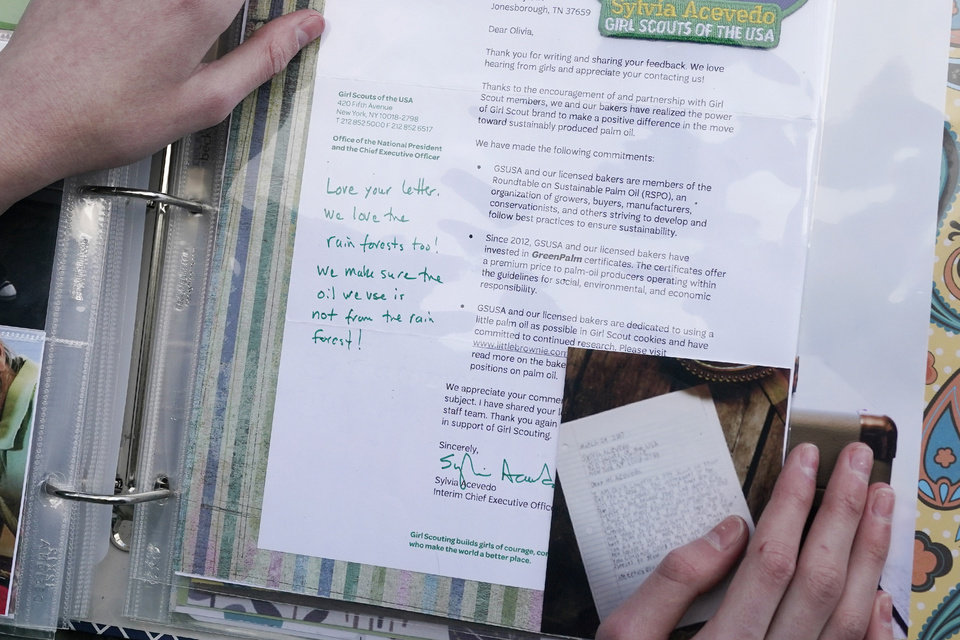 Photo -  Olivia Chaffin displays a 2017 response she received from the chief executive officer of the Girl Scouts to her concerns with palm oil being used in Girl Scout Cookies in Jonesborough, Tenn., on Sunday, Nov. 1, 2020.
