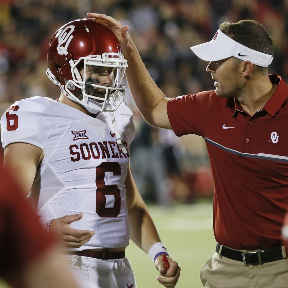 Photo - OU offensive coordinator Lincoln Riley greets Baker Mayfield (6) after a two-point conversion in the fourth quarter a college football game between the University of Oklahoma Sooners (OU) and Texas Tech Red Raiders at Jones AT&T Stadium in Lubbock, Texas, Saturday, Oct. 22, 2016. OU won 66-59. Photo by Nate Billings, The Oklahoman