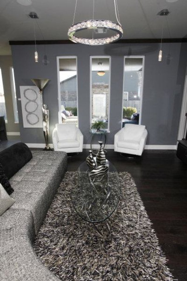 Photo - Left: A reconfigurable sofa has cushions that can be piled in different ways to accommodate different guests in the Jeff Click model home in the Silverhawk addition. Photo by Steve Gooch,  The Oklahoman