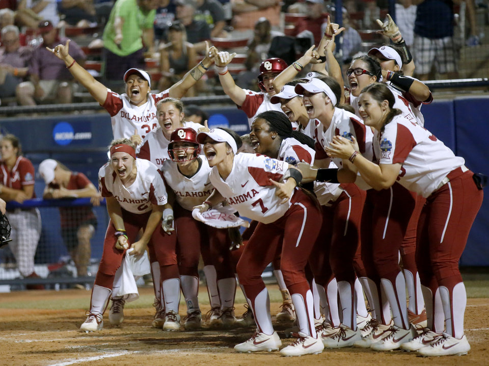 Photo - Oklahoma celebrates the home run on Jocelyn Alo (78) in the 5th inning during a Women's College World Series between Oklahoma and Alabama at USA Softball Hall of Fame Stadium in Oklahoma City,  Sunday, June 2, 2019. Oklahoma won 7-3. [Sarah Phipps/The Oklahoman]