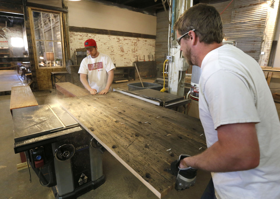 Sam Nicholson, Left, And Daniel Burgess Saw The Edge Of A Table Top Monday  At Urban Farmhouse In Oklahoma City. PAUL HELLSTERN   Oklahoman