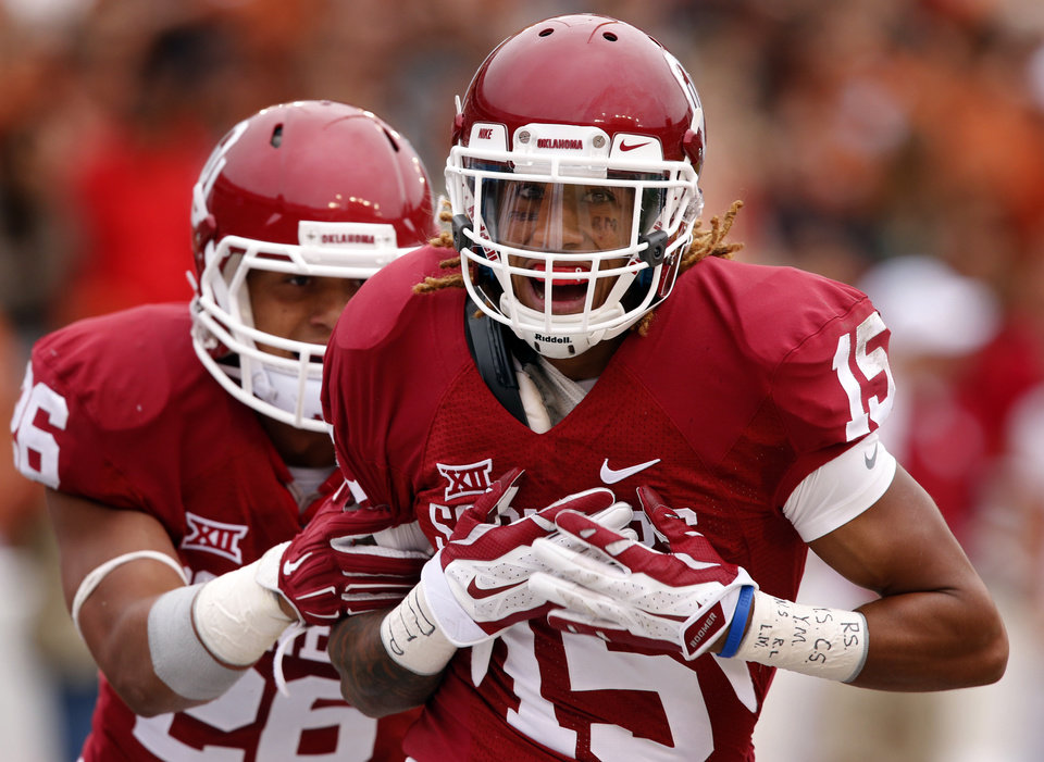 Photo - Oklahoma's Zack Sanchez (15) is congratulated after an interception and return for a touchdown during the Red River Showdown college football game between the University of Oklahoma Sooners (OU) and the University of Texas Longhorns (UT) at the Cotton Bowl in Dallas, Texas on Saturday, Oct. 11, 2014. 
