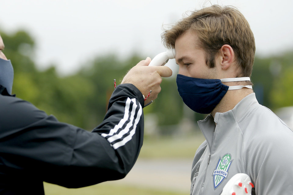 Photo - Tucker Stephenson with OKC Energy FC has his temperature taken as he arrives for soccer practice in Oklahoma City, Wednesday, May 13, 2020. [Bryan Terry/The Oklahoman]
