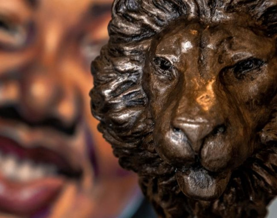 Photo -  A lion's head sculpture is one of the details of artist Scott Stearman's art piece