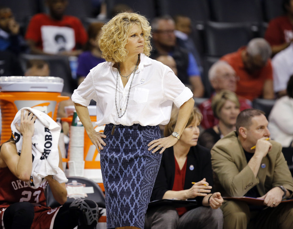 Photo - OU coach Sherri Coale watches her team from the bench during a semifinal game in the Big 12 Women's Basketball Championship between the Oklahoma Sooners (OU) and the Baylor Lady Bears at Chesapeake Energy Arena in Oklahoma City, Sunday, March 6, 2016. Baylor won 84-57. Photo by Nate Billings, The Oklahoman