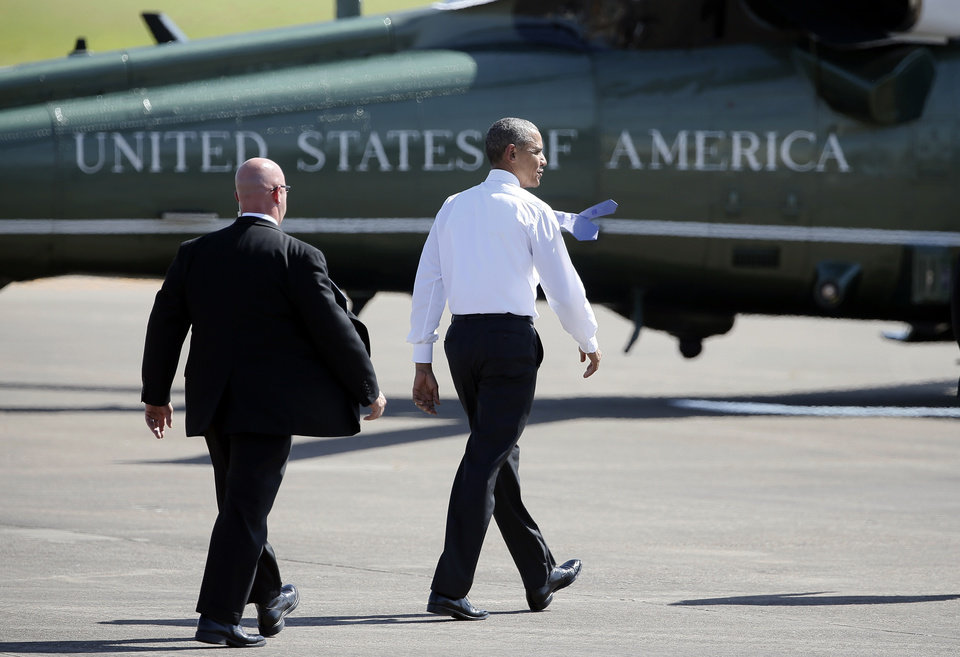 Photo - President Barack Obama walks over to Marine One for departure after greeting a welcome party after his arrival at the North Texas Regional Airport in Denison, Texas, July 15, 2015. (AP Photo/Tony Gutierrez)