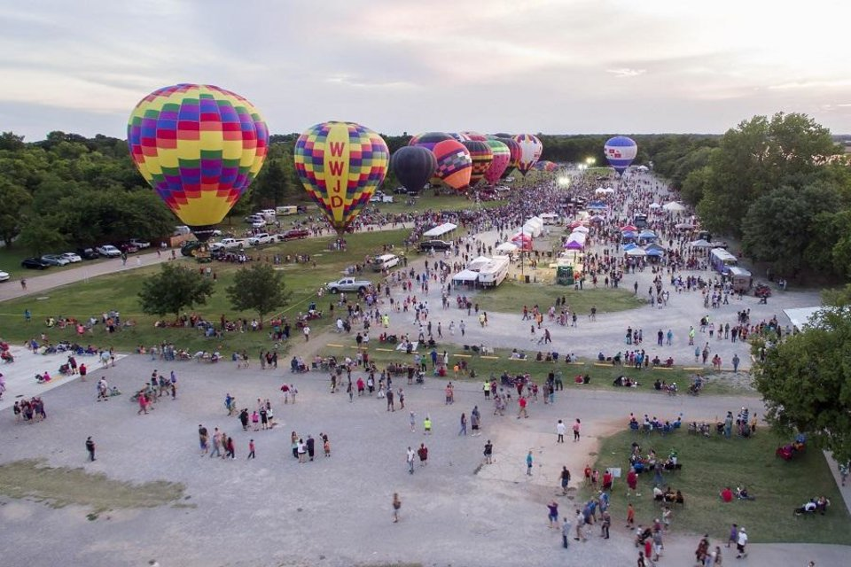 Photo - A crowd gathers during the 2018 FireLake Fireflight Balloon Festival, Saturday, Aug. 11, 2018, in Shawnee. [Photo provided]