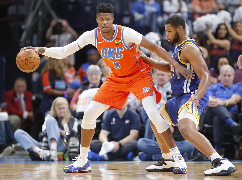 Photo - Oklahoma City's Justin Patton (13) looks to get around Golden State's Omari Spellman (4) during the NBA game between the Oklahoma City Thunder and Golden State Warriors at Chesapeake Energy Arena,  Sunday, Oct. 27, 2019. Thunder won 120-92.[Sarah Phipps/The Oklahoman]