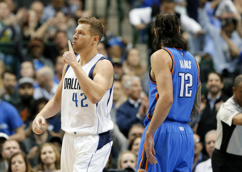 Photo - Dallas Mavericks forward David Lee (42) celebrates sinking a basket with a foul called against the Oklahoma City Thunder as Steven Adams (12) of New Zealand watches in the first half of an NBA basketball game, Wednesday, Feb. 24, 2016, in Dallas. (AP Photo/Tony Gutierrez)