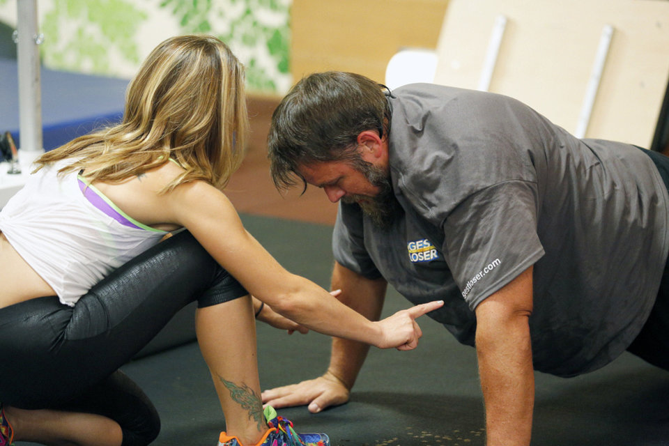 Photo - Trainer Jillian Michaels works with David Brown of Edmond during season 15 of