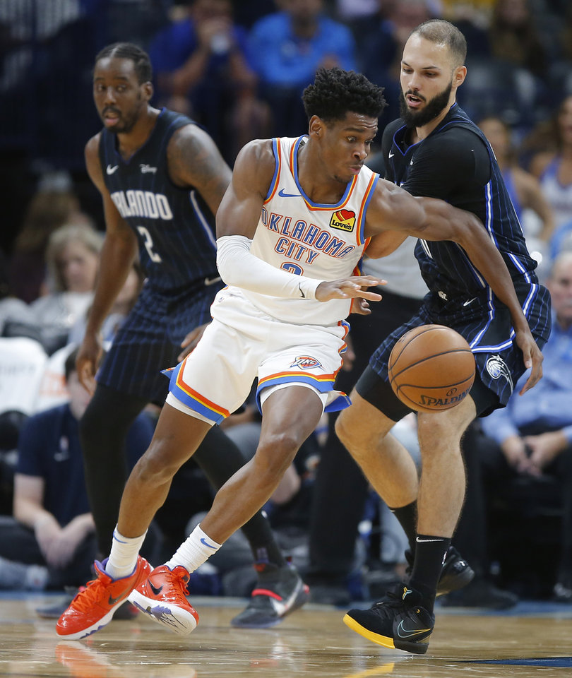 Photo - Oklahoma City's Shai Gilgeous-Alexander (2) goes past Orlando's Evan Fournier (10) during an NBA basketball game between the Oklahoma City Thunder and the Orlando Magic at Chesapeake Energy Arena in Oklahoma City, Tuesday, Nov. 5, 2019. Oklahoma City won 102-94. [Bryan Terry/The Oklahoman]
