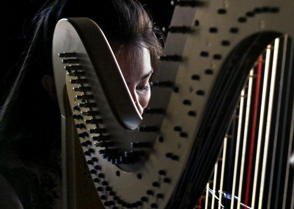 Photo - Yiskah performs on the harp during Norman Music Fest 2019 on April 27, 2019 in Norman, Okla.  [Steve Sisney/For The Oklahoman]