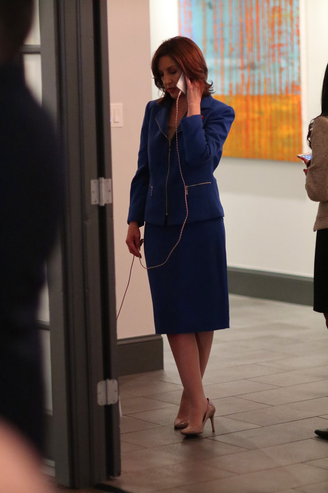 Photo - Joy Hofmeister, candidate for Oklahoma Schools Superintendent, talks on the phone in the hall where it's quiet, at her Republican runoff watch party, Tuesday, August 28, 2018.  Photo by Doug Hoke, The Oklahoman