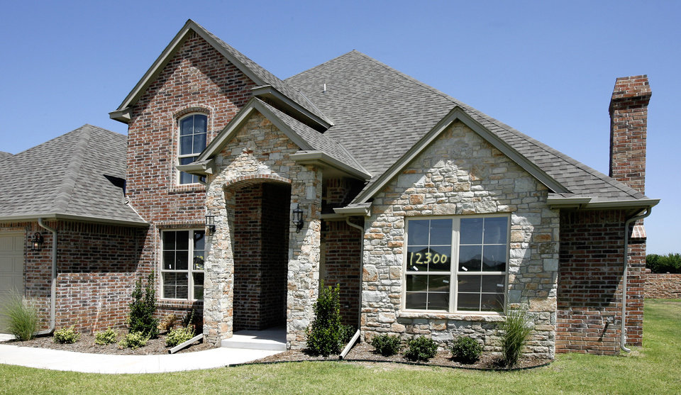 HOUSE: Exterior Of 12300 Chateaux Road In The Chateaux At Cobblestone  Housing Addition In Oklahoma City Wednesday, August 8, 2007. BY PAUL B.  SOUTHERLAND, ...