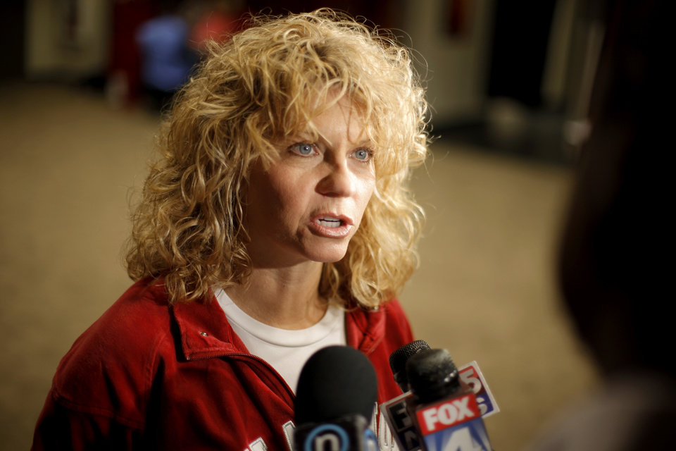 Photo - OU coach Sherri Coale is interviewed in the locker room in Kansas City, Mo., on Monday, March 29, 2010. Oklahoma will play Kentucky in the regional championship game of the NCAA women's tournament on Tuesday, March 29, 2010.