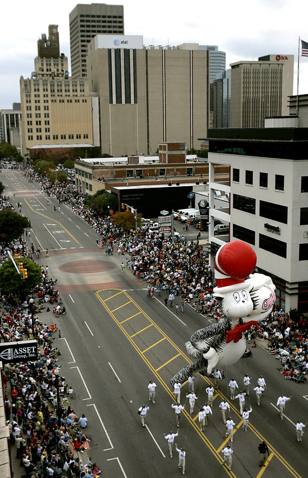 Photo - The Cat in the Hat baloon makes his way down Broadway during the Oklahoma Centennial Parade in Oklahoma City on Sunday, Oct. 14, 2007. By John Clanton, The Oklahoman