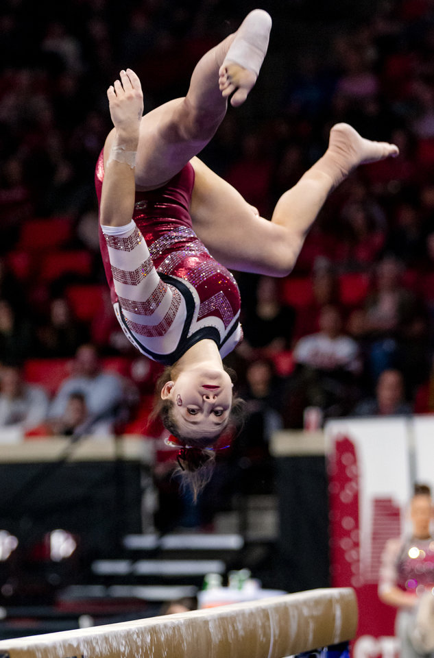 Photo - University of Oklahoma's Karrie Thomas competes in the beam during the women's gymnastics competition between the University of Oklahoma and Arkansas at the Lloyd Noble Center in Norman, Okla Monday, Jan. 20, 2020.   [Chris Landsberger/The Oklahoman]