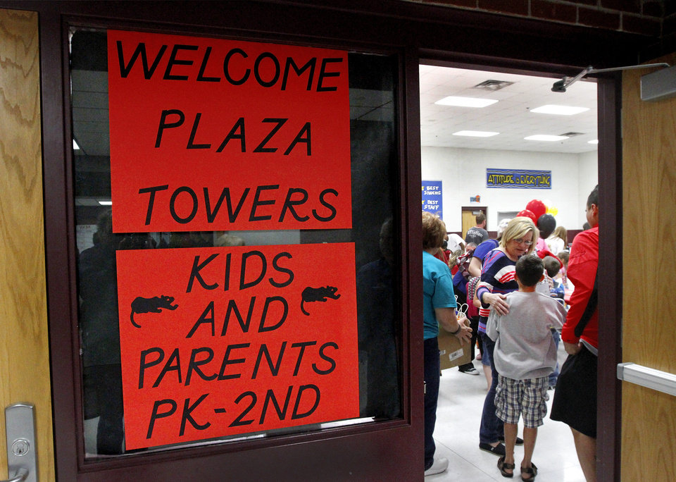 Photo - Students and faculty at Eastlake decorated the front part of their school to make it as welcoming g as possible for Plaza Towers students and parents. There was lots of hugging and plenty of joy at Eastlake Elementary School on SW 134, when Eastlake School hosted a reunion of students, parents, teachers and families from Plaza Towers Elementary School on Thursday, May 23, 2013. Seven students died at Plaza Towers School in Monday's EF5 tornado, which also destroyed the school.  Photo  by Jim Beckel, The Oklahoman.
